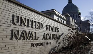 This Jan. 9, 2014 photo shows a sign outside of an entrance to the U.S. Naval Academy campus in Annapolis, Md. (AP Photo/Patrick Semansky) **FILE**