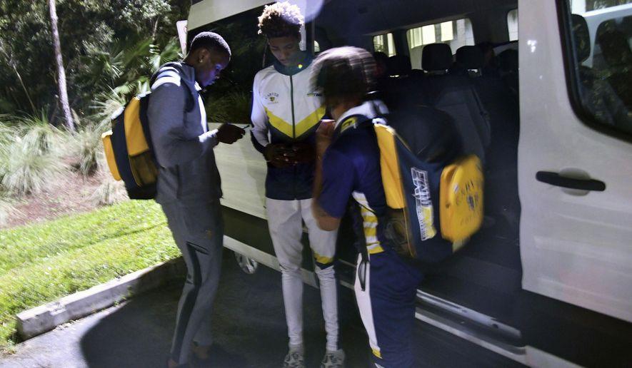 Carver College get in their van before heading back to Atlanta, Ga., after their NCAA college basketball game against Florida International Monday, Dec. 21, 2020, in Miami. (AP Photo/Gaston De Cardenas)