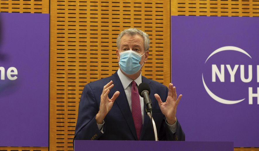 Mayor Bill de Blasio delivers remarks ahead of the first COVID-19 vaccinations at NYU-Langone Hospital on Monday, Dec. 14, 2020, in New York. Hundreds of thousands of health care workers across the country are expected to receive the vaccine this week. (AP Photo/Kevin Hagen).