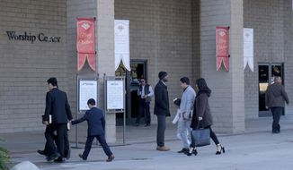 People arrive for the Sunday 8:30 a.m. service at Grace Community Church in Sun Valley, Calif., on Dec. 20, 2020. (Dean Musgrove/The Orange County Register via AP)