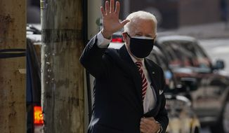 President-elect Joe Biden waves as he arrives at The Queen Theater in Wilmington, Del., Wednesday, Dec. 23, 2020. (AP Photo/Carolyn Kaster)