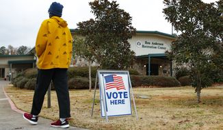 A voter walks to the entrance during early voting for the Senate runoff election, at Ron Anderson Recreation Center, Thursday, Dec. 17, 2020, in Powder Springs, Ga. (AP Photo/Todd Kirkland)