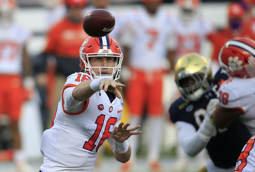 In this Saturday, Dec. 19, 2020, file photo, Clemson quarterback Trevor Lawrence (16) throws to an open receiver during the first half of the Atlantic Coast Conference championship NCAA college football game against Notre Dame in Charlotte, N.C. Lawrence has been named a finalist for the Heisman Trophy. The Heisman will be awarded Jan. 5 during a virtual ceremony as the pandemic forced the cancellation of the usual trip to New York that for the presentation that usually comes with being a finalist.  (AP Photo/Brian Blanco, File) **FILE**