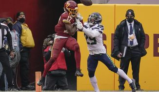 Seattle Seahawks free safety D.J. Reed (29) stops Washington Football Team wide receiver Terry McLaurin (17) from making a catch in the end zone during the second half of an NFL football game, Sunday, Dec. 20, 2020, in Landover, Md. (AP Photo/Andrew Harnik)