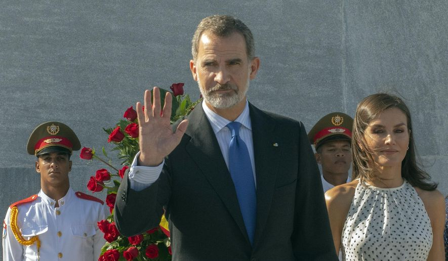 In this Tuesday, Nov. 12, 2019 file photo, Spain's King Felipe VI waves as Queen Letizia walks with him at Revolution Square in Havana, Cuba. (AP Photo/Ramon Espinosa, File)