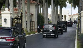 President Donald Trump's motorcade arrives at Trump International Golf Club, Thursday, Dec. 24, 2020, in West Palm Beach, Fla. (AP Photo/Patrick Semansky)