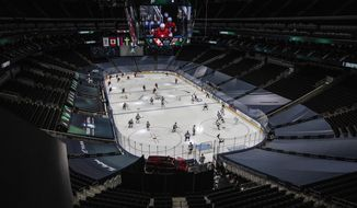 Switzerland and Austria take to the ice before first period IIHF World Junior Hockey Championship pre-competition action in Edmonton, Alberta, on Tuesday, Dec. 22, 2020. (Jason Franson/The Canadian Press via AP)