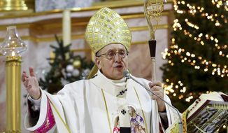 Belarus Roman Catholic Archbishop Tadeusz Kondrusiewicz leads a Christmas midnight mass at the Church of Saints Simon and Helena during in Minsk, Belarus, Thursday, Dec. 24, 2020. Belarusian authorities have allowed Roman Catholic priest Kondrusiewicz to return to the country after denying him entry for months. Kondrusiewicz was barred from entering the ex-Soviet nation for nearly four months after his criticism of the Belarusian authorities' crackdown on protests. (AP Photo)