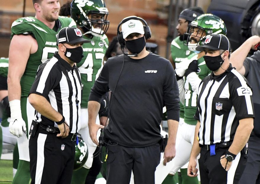 New York Jets head coach Adam Gase, center, looks on during a replay call in the second half of an NFL football game against the Los Angeles Rams in Inglewood, Calif., Sunday, Dec. 20, 2020. (Keith Birmingham/The Orange County Register via AP)