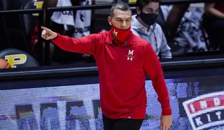Maryland head coach Mark Turgeon directs his team during the first half of an NCAA college basketball game against Purdue in West Lafayette, Ind., Friday, Dec. 25, 2020. (AP Photo/Michael Conroy)