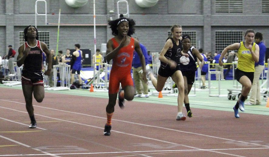 FILE - In this Feb. 7, 2019 file photo, Bloomfield High School transgender athlete Terry Miller, second from left, wins the final of the 55-meter dash over transgender athlete Andraya Yearwood, far left, and other runners in the Connecticut girls Class S indoor track meet at Hillhouse High School in New Haven, Conn. In a response to a complaint that transgender female runners had an unfair physical advantage, the U.S. Education Department in May 2020, determined that Connecticut's policy of allowing transgender girls to compete as girls in high school sports violates the civil rights of athletes who have always identified as female. (AP Photo/Pat Eaton-Robb, File)
