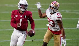 Arizona Cardinals quarterback Kyler Murray (1) runs as San Francisco 49ers cornerback Ahkello Witherspoon (23) defends during the second half of an NFL football game, Saturday, Dec. 26, 2020, in Glendale, Ariz. (AP Photo/Ross D. Franklin)