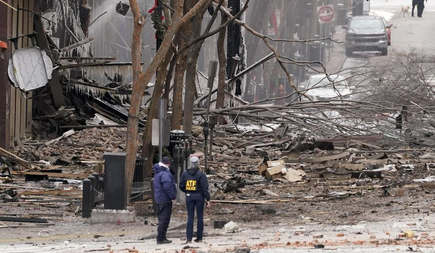 Emergency personnel work near the scene of an explosion in downtown Nashville, Tenn., Friday, Dec. 25, 2020. Buildings shook in the immediate area and beyond after a loud boom was heard early Christmas morning.(AP Photo/Mark Humphrey) ** FILE **