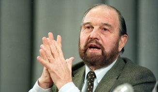 """FILE - In this Jan. 15, 1992 file photo, George Blake, a former British spy who doubled as a Soviet agent, gestures during a news conference in Moscow. Blake, a former British intelligence officer who worked as a double agent for the Soviet Union, has died in Russia. He was 98. Russia's Foreign Intelligence Service announced his death on Saturday, Dec. 26, 2020 without giving any circumstances of his death. Russian President Vladimir Putin expressed condolences, hailing Blake as a """"brilliant professional"""" and a man of """"remarkable courage."""" (AP Photo/Boris Yurchenko, File)"""