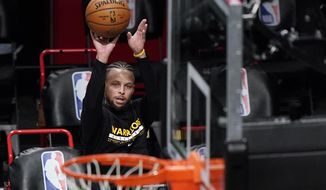Golden State Warriors guard Stephen Curry shoots as players warm up for the team's NBA basketball game against the Brooklyn Nets, Tuesday, Dec. 22, 2020, in New York. (AP Photo/Kathy Willens)