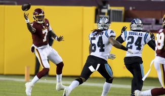 Washington Football Team quarterback Dwayne Haskins (7) makes a throw during an NFL football game against the Carolina Panthers, Sunday, Dec. 27, 2020 in Landover, Md. (AP Photo/Daniel Kucin Jr.)
