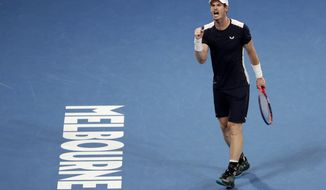 FILE - In this Jan 14, 2019, file photo, Britain's Andy Murray reacts after winning a point against Spain's Roberto Bautista Agut during their first round match at the Australian Open tennis championships in Melbourne, Australia. Five-time Australian Open finalist Murray has been given a wild-card entry into the first Grand Slam tournament of next year. (AP Photo/Mark Schiefelbein, File)