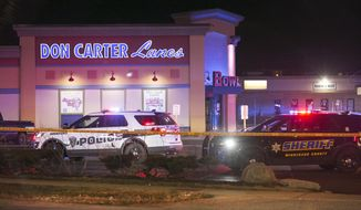 Rockford police and other law enforcement agencies investigate the scene of a shooting at a bowling alley Saturday, Dec. 26, 2020, in Rockford, Ill. (Scott P. Yates/Rockford Register Star via AP)