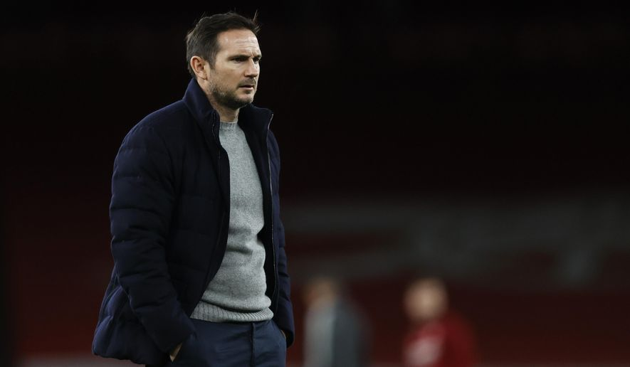 Chelsea's head coach Frank Lampard watches his player warm up ahead of the English Premier League soccer match between Arsenal and Chelsea at the Emirates stadium in London, Saturday, Dec. 26, 2020. (Adrian Dennis/ Pool via AP)