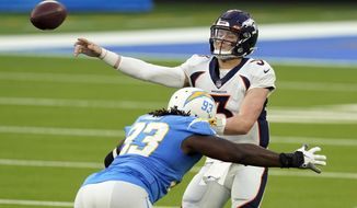 Denver Broncos quarterback Drew Lock (3) throws under pressure from Los Angeles Chargers defensive tackle Justin Jones during the second half of an NFL football game Sunday, Dec. 27, 2020, in Inglewood, Calif. (AP Photo/Ashley Landis)
