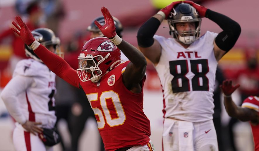 Kansas City Chiefs linebacker Willie Gay (50) reacts next to Atlanta Falcons' Luke Stocker (88) after Falcons place kicker Younghoe Koo missed a 39-yard field goal during the second half of an NFL football game, Sunday, Dec. 27, 2020, in Kansas City. The Chiefs defeated the Falcons 17-14. (AP Photo/Charlie Riedel)