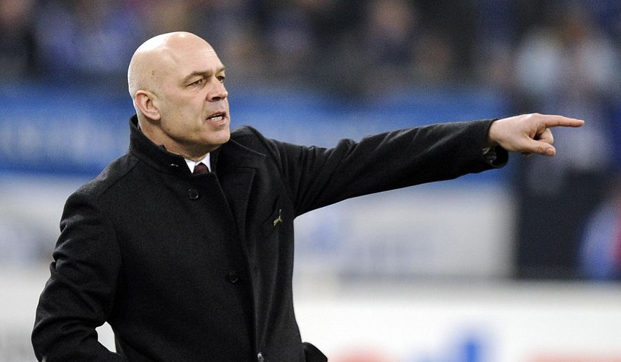 FILE - In this March 12, 2010 file photo, Stuttgart's head coach Christian Gross reacts during the German first division Bundesliga soccer match between FC Schalke 04 and VfB Stuttgart in Gelsenkirchen. Christian Gross returns to Schalke ten years later as new head coach of the struggling Bundesliga team. After David Wagner, Manuel Baum and interims coach Huub Stevens, the Swiss is the 4th head coach for Schalke this season. (AP Photo/Martin Meissner, File)