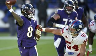 Baltimore Ravens quarterback Lamar Jackson (8) looks to throw a pass as New York Giants inside linebacker Blake Martinez (54) applies pressure during the first half of an NFL football game, Sunday, Dec. 27, 2020, in Baltimore. (AP Photo/Gail Burton)