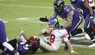 New York Giants quarterback Daniel Jones (8) is sacked by Baltimore Ravens linebacker Chris Board, let, as defensive end Derek Wolfe (95) helps bring him down during the second half of an NFL football game, Sunday, Dec. 27, 2020, in Baltimore. The Ravens won 27-13. (AP Photo/Nick Wass)