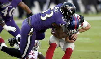 Baltimore Ravens defensive end Jihad Ward (53) sacks New York Giants quarterback Daniel Jones (8) during the second half of an NFL football game, Sunday, Dec. 27, 2020, in Baltimore. (AP Photo/Gail Burton)
