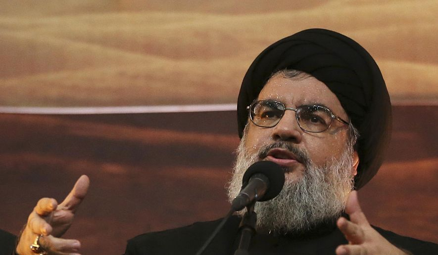 In this Nov. 3, 2014 file photo, Hezbollah leader Hassan Nasrallah addresses supporters in the southern suburb of Beirut, Lebanon. The Hezbollah leader said Tuesday, Sept. 29, 2020, they still welcome the French initiative to help Lebanon out of its crisis, but said Paris has to change its approach in dealing with local factions and not blame everyone for the failure of forming a new Cabinet. (AP Photo/Hussein Malla, File)