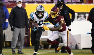 Carolina Panthers wide receiver Curtis Samuel (10) runs with the ball as he is chased by Washington Football Team defensive back Jeremy Reaves (39) during the first half of an NFL football game, Sunday, Dec. 27, 2020, in Landover, Md. (AP Photo/Susan Walsh) **FILE**