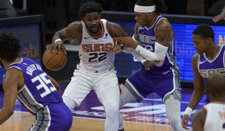 Phoenix Suns center Deandre Ayton (22) works the ball past Sacramento Kings center Richaun Holmes (22) during the first quarter of an NBA basketball game in Sacramento, Calif., Sunday, Dec. 27, 2020. (AP Photo/Randall Benton)