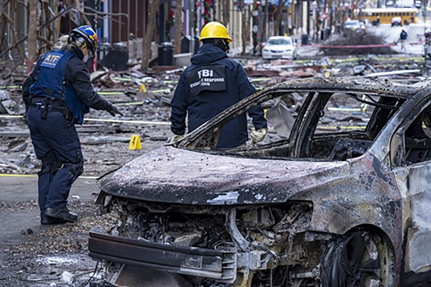 In this photo provided by the FBI and Bureau of Alcohol, Tobacco, Firearms and Explosives, FBI and ATF Evidence Response Teams process the scene, Monday, Dec. 28, 2020, of the Christmas Day blast in Nashville, Tenn. The teams are searching for evidence to assist in the ongoing investigation. (FBI/ATF via AP)