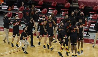 The Maryland bench react after an NCAA college basketball game Wisconsin Monday, Dec. 28, 2020, in Madison, Wis. Maryland won 70-64. (AP Photo/Morry Gash) **FILE**