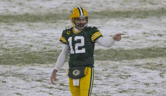 Green Bay Packers quarterback Aaron Rodgers (12) reacts to a completed pass during an NFL football game, Sunday, Dec 27. 2020, between the Tennessee Titans and Green Bay Packers in Green Bay, Wis. (AP Photo/Jeffrey Phelps)