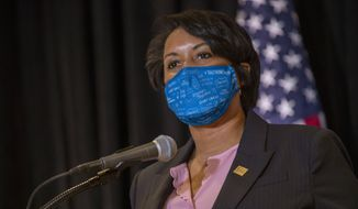 """In this Dec. 17, 2020, file photo, District of Columbia Mayor Muriel Bowser speaks during a news conference in Washington. Homicides in Detroit, New York, Philadelphia and other cities have topped 2019 numbers as violence surged while much of the U.S. struggled during the coronavirus pandemic.""""We're all sick of the heinous crimes in our city,"""" said Bowser.(Shawn Thew/Pool via AP,  File) **FILE**"""