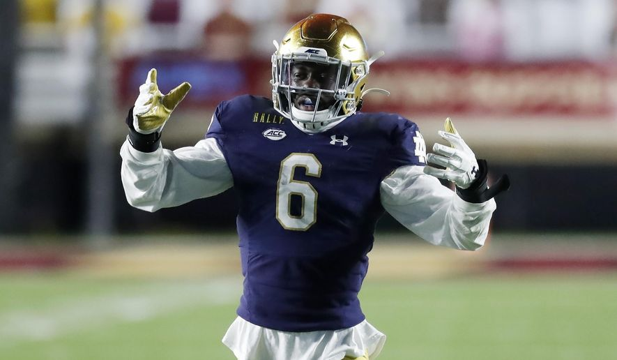 Notre Dame linebacker Jeremiah Owusu-Koramoah plays against Boston College during the second half of an NCAA college football game, Saturday, Nov. 14, 2020, in Boston. Owusa-Koramoah was selected to The Associated Press All-America first-team defense, Monday, Dec. 28, 2020.(AP Photo/Michael Dwyer) **FILE**