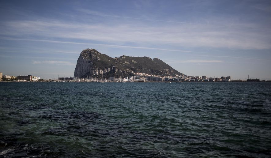 FILE - In this Thursday, Oct. 17, 2019 file photo, an eerial view of Gibraltar rock seen from the neighbouring Spanish city of La Linea, during a general election in Gibraltar. (AP Photo/Javier Fergo, File)