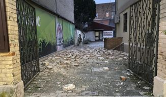 A view of a debris on a path caused by an earthquake in Sisak, Croatia, Monday, Dec. 28, 2020. A moderate earthquake has hit central Croatia near its capital of Zagreb, triggering panic and some damage south of the city. There were no immediate reports of injuries. (AP Photo/Goran Juric)