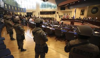 FILE - In this Feb. 9, 2020 file photo, armed Special Forces soldiers of the Salvadoran Army, following orders of President Nayib Bukele, enter congress upon the arrival of lawmakers, in San Salvador, El Salvador. Opposition lawmakers recommended on Thursday, Dec. 17, 2020, that President Bukele dismiss the director of the National Police and the chief of the armed forces, because of serious human rights violations that occurred when the armed forces entered congress. (AP Photo/Salvador Melendez, File)