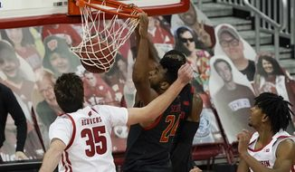 Maryland's Donta Scott dunks during the second half of an NCAA college basketball game against Wisconsin Monday, Dec. 28, 2020, in Madison, Wis. (AP Photo/Morry Gash)