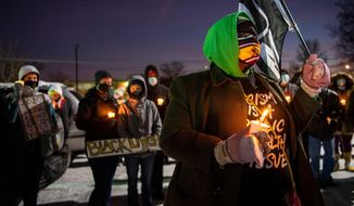 A vigil is held for Andre' Hill at the Brentnell Community Recreation Center on Columbus. Ohio, Saturday, Dec. 26, 2020. The police chief of Columbus, Ohio, recommended on Thursday, Dec. 24, 2020, that the officer who shot and killed Hill, a 47-year-old Black man, earlier this week be fired. (Gaelen Morse/The Columbus Dispatch via AP)