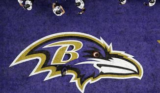 The Baltimore Ravens walk past the team logo in the end zone during warmups for the NFL Super Bowl XLVII football game against the San Francisco 49ers in New Orleans, in this Sunday, Feb. 3, 2013, file photo. The Baltimore Ravens were fined $250,000 by the NFL for violating COVID-19 protocols, a person with direct knowledge of the punishment told The Associated Press on Monday, Dec. 28, 2020. (AP Photo/David J. Phillip, File) **FILE**