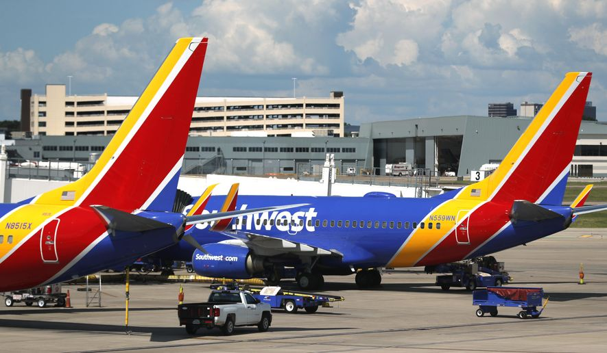 FILE - In this Wednesday, June 24, 2020, file photo, Southwest Airlines jets sit at gates at Love Field in Dallas. On Thursday, Dec. 3, 2020, the airline warned nearly 7,000 employees that they could lose their jobs unless labor unions accept concessions to help Southwest cope with a sharp drop in travel during the pandemic. (AP Photo/Tony Gutierrez, File)