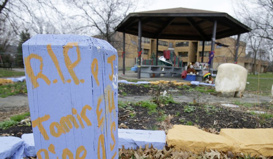 """""""R.I.P. Tamir Rice"""" is written on a wooden post near a makeshift memorial at the gazebo where the boy was fatally shot, outside the Cudell Recreation Center in Cleveland. (AP Photo/Tony Dejak, File)"""