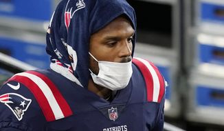New England Patriots quarterback Cam Newton walks along the sideline in the first half of an NFL football game against the Buffalo Bills, Monday, Dec. 28, 2020, in Foxborough, Mass. (AP Photo/Elise Amendola)