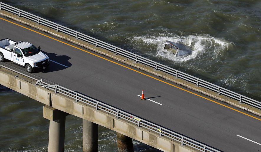 A box truck floats in the water after driving off the Chesapeake Bay Bridge-Tunnel Tuesday morning Dec. 29, 2020, near Virginia Beach, Va. (Jonathon Gruenke/The Daily Press via AP)