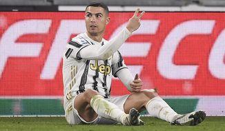 Juventus' Cristiano Ronaldo gestures during the Serie A soccer match between Juventus and Fiorentina, at the Allianz Stadium in Turin, Italy, Tuesday, Dec. 22, 2020. (Fabio Ferrari/LaPresse via AP)