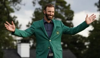 Masters golf champion Dustin Johnson shows off his green jacket after his victory in Augusta, Ga., in this Sunday, Nov. 15, 2020, file photo. Johnson was sure to send Phil Mickelson a text about his whereabouts next year the night of the champions dinner. (AP Photo/Matt Slocum, File) ** FILE**
