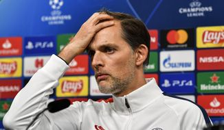 FILE - In this file photo Feb. 17, 2020, PSG's head coach Thomas Tuchel listens to the media at a press conference prior the Champions League soccer match in Dortmund, Germany. Paris Saint-Germain has fired coach Thomas Tuchel while the defending champion is in third place in the French league. Tuchel's dismissal on Thursday, Dec. 24, 2020 came the day after PSG beat Strasbourg 4-0 and after Tuchel was questioned about comments he made to German broadcaster SPORT1.(AP Photo/Martin Meissner, File)